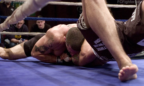 Ring of Combat 16: Mike Massenzio finishing off Erik Charles with a choke from North-South position - Photo by Tom DeFazio