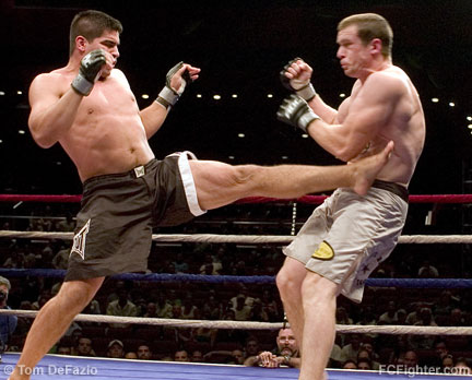 Ring of Combat XV: Ricardo Romero sends Bryce Harrell reeling with a front kick - Photo by Tom DeFazio